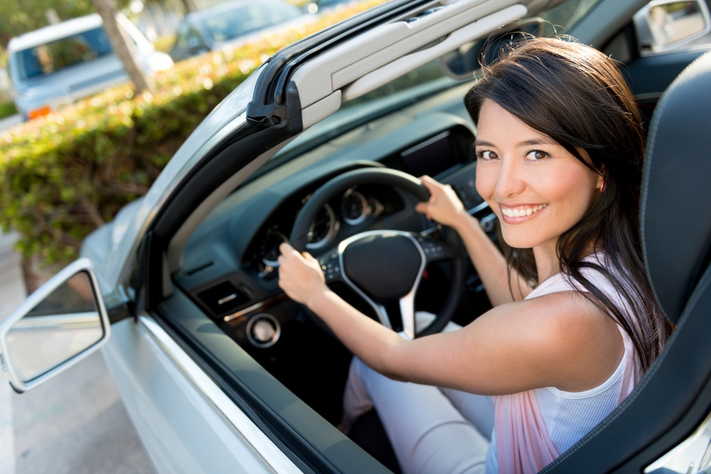 woman in a pre-owned luxury vehicle