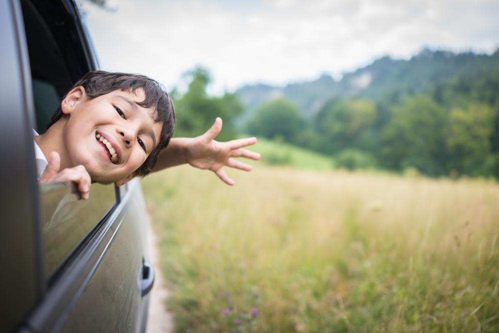 Happy kid in car