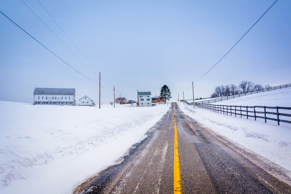 Snow covered farm along a country road in rural York County, Pennsylvania.